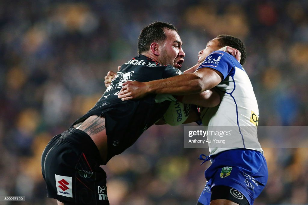 Bodene Thompson of the Warriors fends against Moses Mbye of the Bulldogs during the round 16 NRL match between the New Zealand Warriors and the Canterbury Bulldogs at Mt Smart Stadium on June 23, 2017 in Auckland, New Zealand.