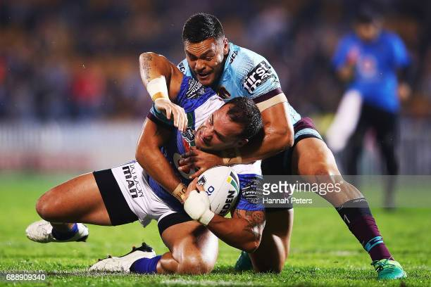 Bodene Thompson of the Warriors is brought down during the round 12 NRL match between the New Zealand Warriors and the Brisbane Broncos at Mt Smart...