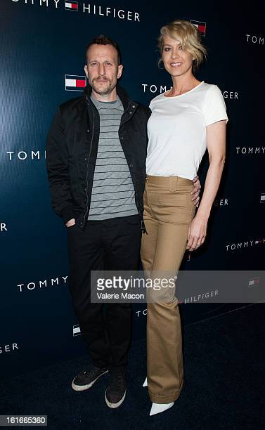 Bodhi Elfman and Jenna Elfman arrives at the Tommy Hilfiger LA Flagship Opening on February 13 2013 in Los Angeles California