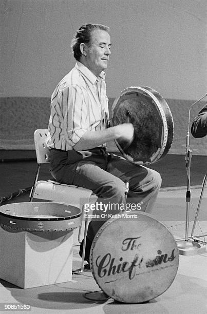 Bodhran player Peadar Mercier of Irish folk group The Chieftains performing on a TV show 1976