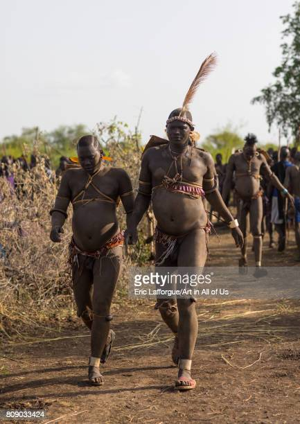 Bodi tribe fat men running during Kael ceremony Omo valley Hana Mursi Ethiopia on June 4 2017 in Hana Mursi Ethiopia