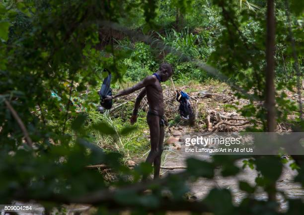 Bodi tribe men taking a bath before the Kael ceremony Omo valley Hana Mursi Ethiopia on June 2 2017 in Hana Mursi Ethiopia