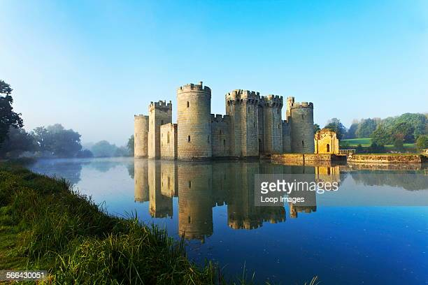 Bodiam Castle an almost perfect example of a 14th century medieval castle reflected in the moat at dawn