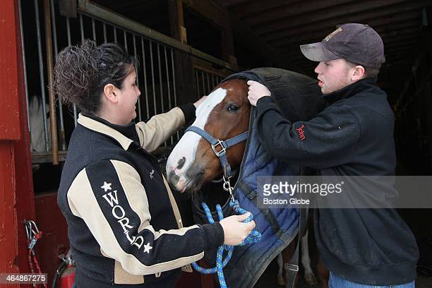 Bodie a Paint Horse at Indian Rock Stables wears two blankets in the winter Paige Benson and her boyfriend John Gill help him out