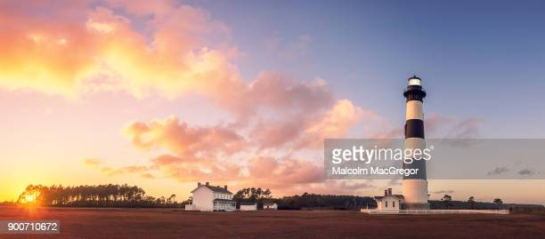 bodie island lighthouse at sunset - outer banks stock pictures, royalty-free photos & images