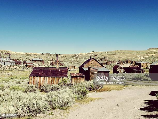 bodie state historic park against clear blue sky - california gold rush stock photos and pictures