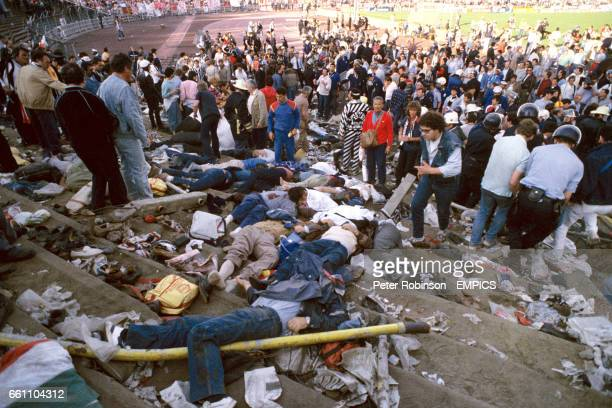 Bodies and possessions litter the terraces in the immediate aftermath of the Heysel Stadium disaster during which 39 Juventus fans died