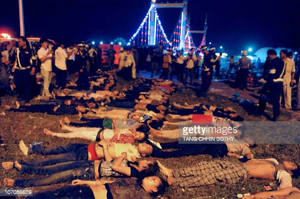Bodies are displayed in front of the suspended bridge where they found death in Phnom Penh on November 23 2010 after at least 330 people died in a...