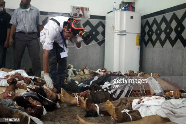 Bodies are laid out in a make shift morgue after Egyptian security forces stormed two huge protest camps at the Rabaa al-Adawiya and Al-Nahda squares...