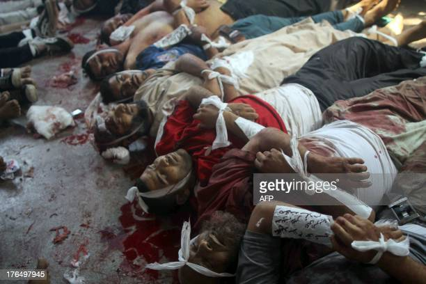 Bodies are laid out in a make shift morgue after Egyptian security forces stormed two huge protest camps at the Rabaa al-Adawiya and Al-Nahda square...