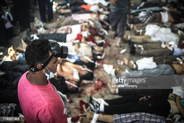 CONTENT] Bodies are laid out in a makeshift morgue after Egyptian security forces stormed two huge protest camps at the Rabaa alAdawiya and AlNahda...