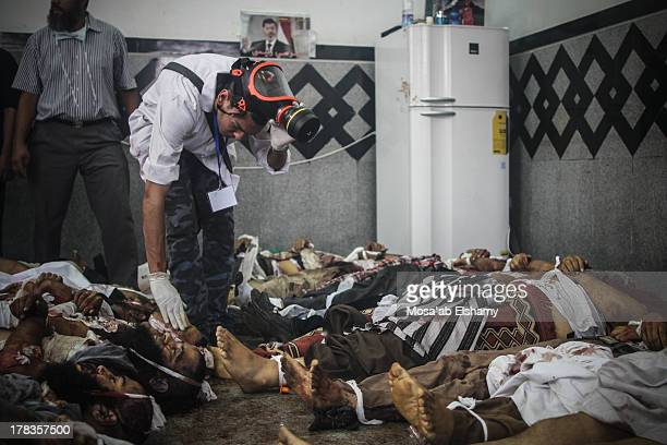 Bodies are laid out in a makeshift morgue after Egyptian security forces stormed two huge protest camps at the Rabaa al-Adawiya and Al-Nahda square...