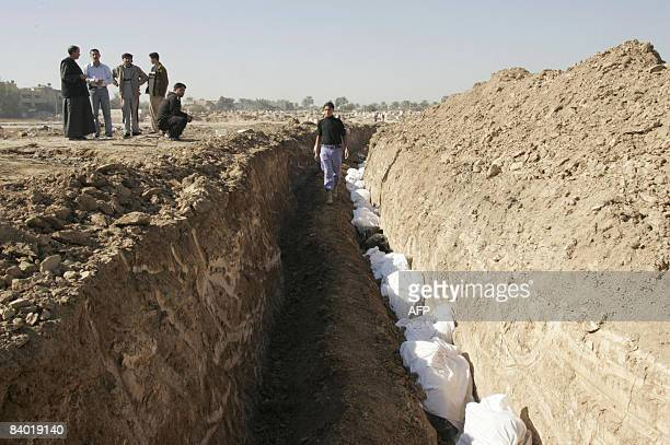 Bodies are laid to rest in a mass grave in the north eastern town of Baquba, some 60 kms from Baghdad on December 13, 2008. Some 105 bodies were...
