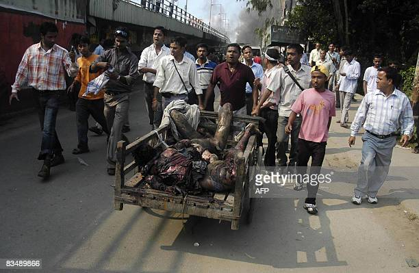 Bodies are moved in a handpuller from the site of a blast in the Ganeshguri area in Guwahati the capital city of India�s northeastern state of Assam...