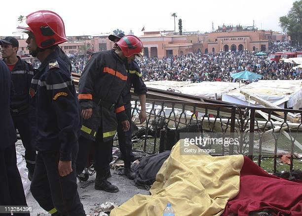 Bodies are removed from the bomb damaged Argana Cafe on April 28 2011 in Marrakech Morocco A remotecontrolled nail bomb exploded and tore through the...