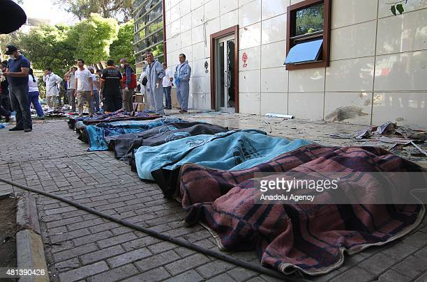 Bodies are seen at the site of an explosion targeting a cultural center in Suruc district of Sanliurfa, Turkey on July 20, 2015. At least 27 people...