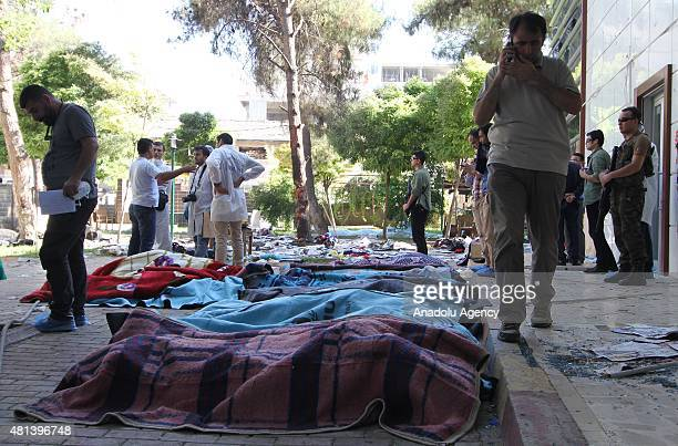 Bodies are seen at the site of an explosion targeting a cultural center in Suruc district of Sanliurfa Turkey on July 20 2015 At least 27 people were...