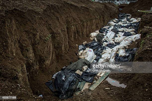 Bodies are seen in a mass grave on the outskirts of Tacloban City on November 20, 2013 in Leyte, Philippines. Typhoon Haiyan, which ripped through...