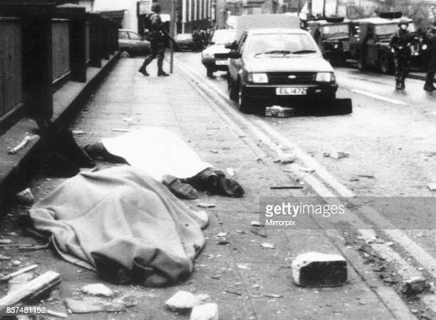 Bodies covered at the roadside Enniskillen Ireland where a 200 pound bomb exploded in a derelict schoolhouse ten minutes before the Rememberence Day...