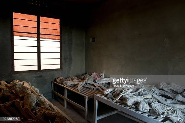 Bodies dug out from mass graves laid on a table in the Murambi memorial center in the south of Rwanda April 19 2008 in Murambi Rwanda An estimated...