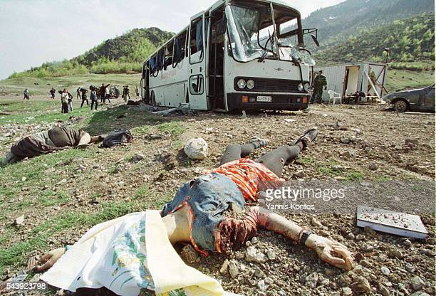 Bodies in front of the shell of the bus | Location Savine Vode Federal Republic of Yugoslavia