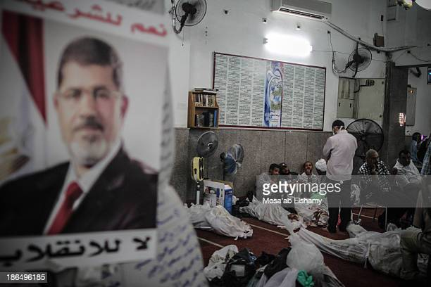 CONTENT] Bodies lay at a Mosque which was turned to a makeshift morgue after the violent dispersal of Rabaa Adaweya square