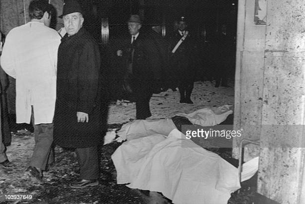 Bodies lay on the ground of the devasted hall of the National Agricultural Bank in Piazza Fontana in Milan on December 12 1969 after a bomb exploded...