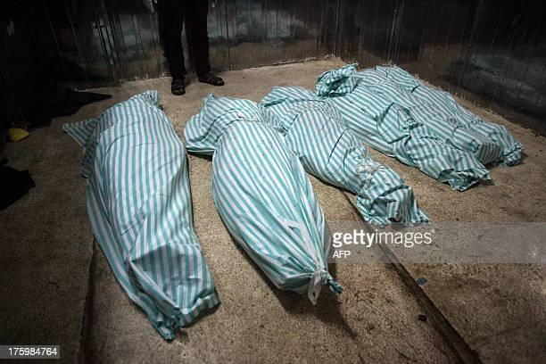 Bodies lie at a morgue following fighting between rebel fighters and Syrian government forces on August 10 2013 in the northern city of Raqqa the...