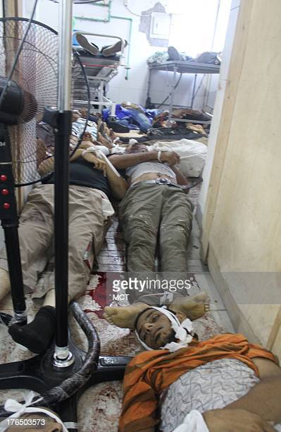 Bodies lie in a makeshift morgue in the basement of Rabaa field hospital near the site of one of two sitins on behalf of ousted Egyptian President...