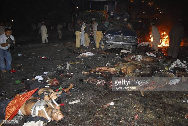Bodies lie in the street after a powerful suicide car bomb blast was detonated near a vehicle carrying former Pakistani Prime Minister Benazir Bhutto...