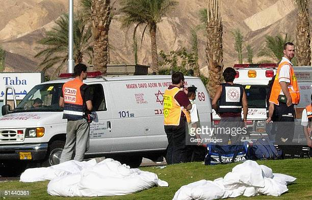 Bodies lie on the grass near emergency in Egyptian resort of Taba on the Red Sea on October 8 2004 in Taba Egypt Some 100 people were wounded and at...