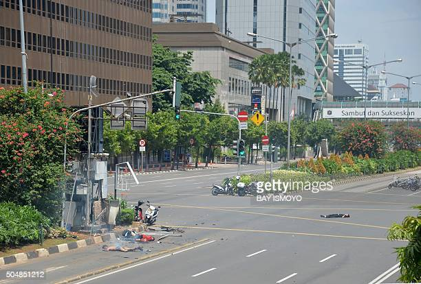 Bodies lie on the street near a damaged police post after a series of blasts hit the Indonesia capital Jakarta on January 14 2016 A series of bombs...