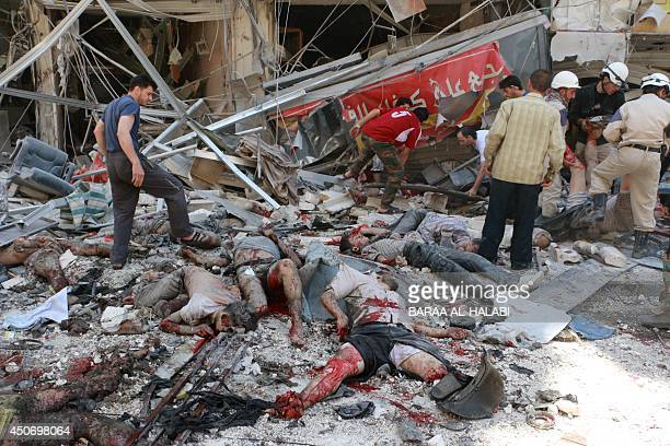 Bodies lie strewn on a street after Syrian regime helicopters allegedly dropped barrel bombs on an oppositionheld district in the northern city of...