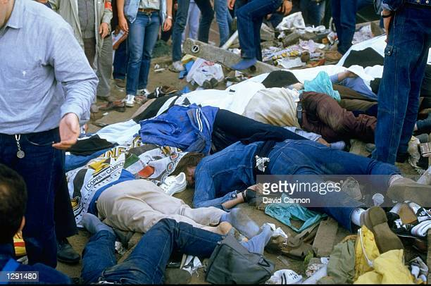 Bodies litter the ground after the crowd riots during the European Cup match between Liverpool and Juventus at the Heysel Stadium in Brussels,...