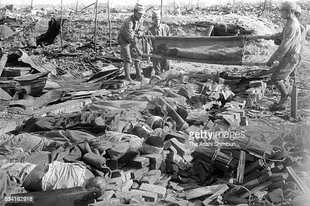Bodies of atomic bomb victims are gathered before cremated in August, 1945 in Hiroshima, Japan. The world's first atomic bomb was dropped on...