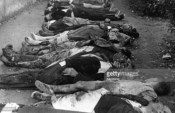 Bodies of children awaiting burial after a Nationalist air raid on their school at Barcelona during the Spanish Civil War