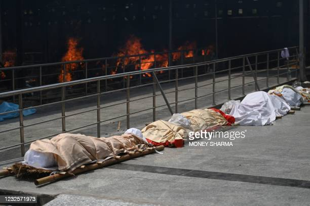 Bodies of Covid-19 coronavirus victims lined up before cremation at a cremation ground in New Delhi on April 28, 2021.