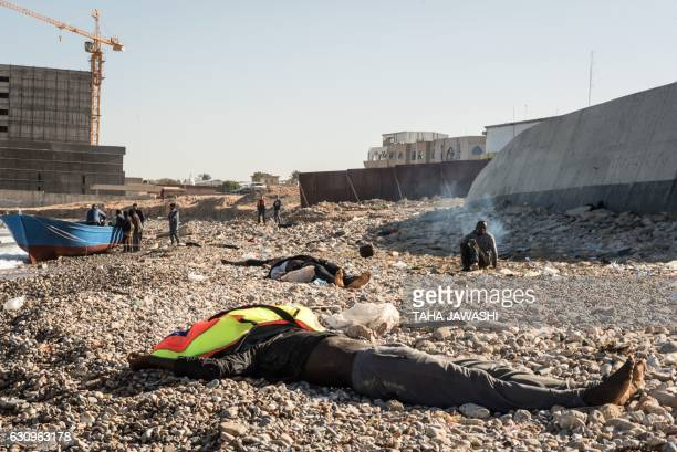 TOPSHOT Bodies of drowned immigrants are seen after they washed ashore in the Andalus district of the capital Tripoli on January 4 2017 After several...
