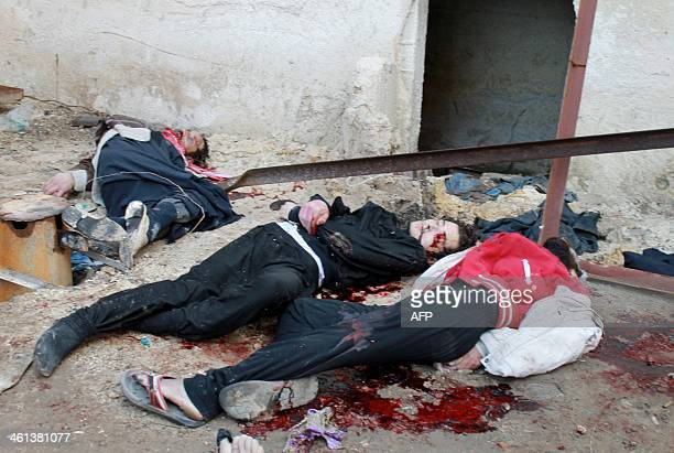 CONTENT Bodies of handcuffed and blindfolded dead men lie on the ground of the Aleppo headquarters of the Islamic State of Iraq and the Levant after...