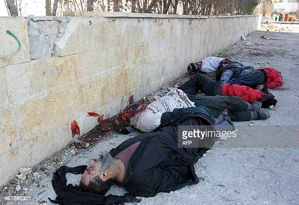 Bodies of handcuffed and blindfolded dead men lie on the ground of the Aleppo headquarters of the Islamic State of Iraq and the Levant after they...