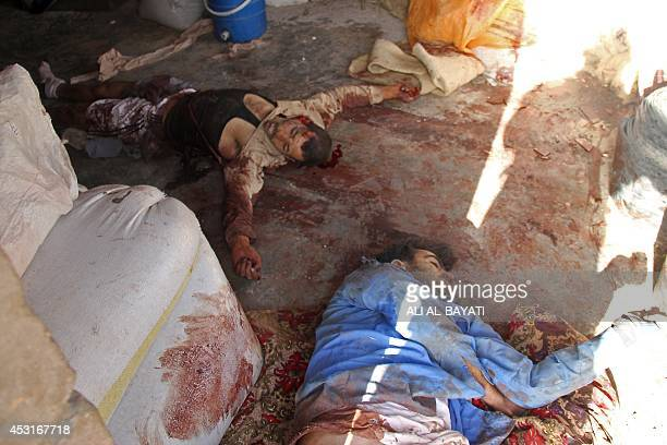 Bodies of Islamic State Sunni militants lie on the ground following fighting with Iraqi security forces, backed by Iraqi Turkmen Shiites, on August...