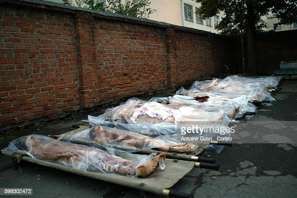 Bodies of loved ones who died in the Beslan school siege sit outside the Vladikavkaz morgue 318 civilians including 186 children died during the...