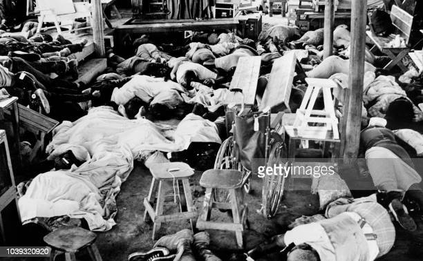 "Bodies of more than 400 members of the Jim Jones' sect ""Temple of people"" lie down, on 19 November 1978, in Jonestown, where the Cult leader Jim..."