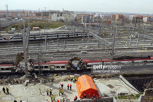 Bodies of victims are evacuated after a train exploded at the Atocha train station in Madrid 11 March 2004 Relatives of many of those killed in the...
