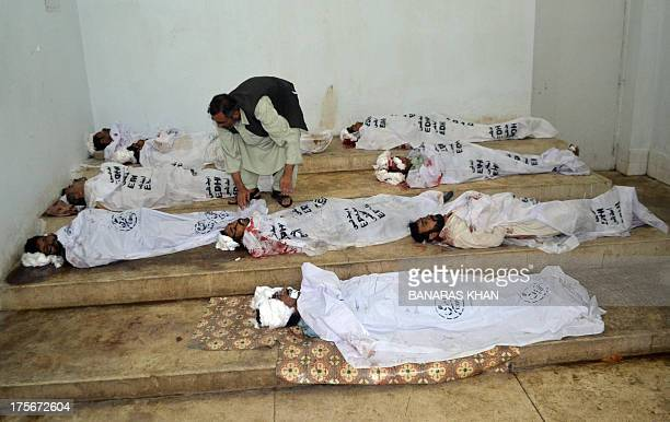Bodies of victims killed by rebels at a fake checkpoint are pictured at a hospital morgue in Quetta on August 6 2013 Separatist rebels killed 14...