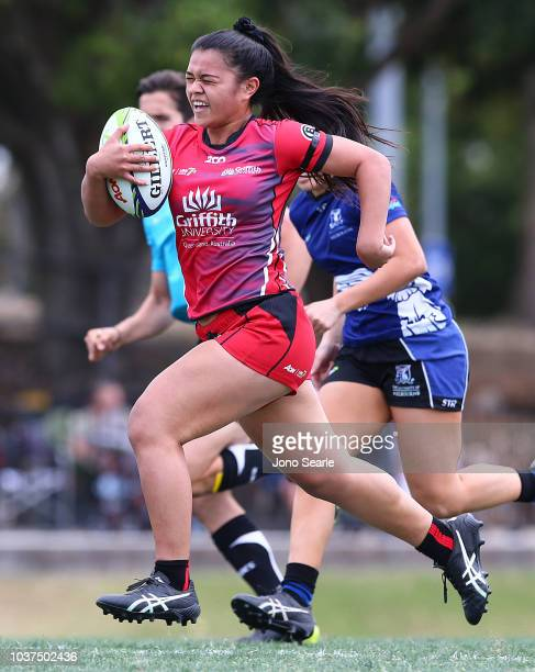 Bodil van Wijnbergen of University of Queensland is tackled during the Aon Uni 7s match between Griffith University and University of Queensland on...