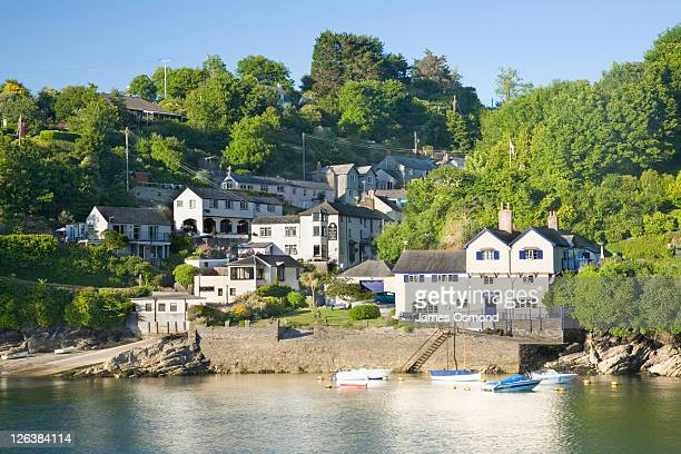 Bodinnick seen across the River Fowey from Fowey, with 'Ferryside', former home of Daphne Du Maurier, on the right. Cornwall. England.
