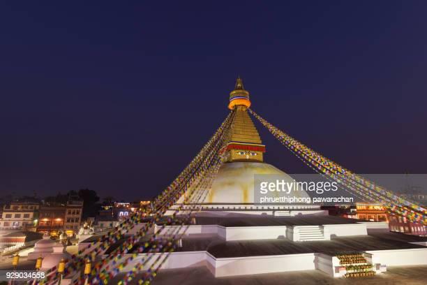 bodnath stupa at twilight, kathmandu, nepal. - kathmandu stock pictures, royalty-free photos & images