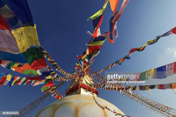 bodnath stupa with prayer flags, kathmandu, nepal. - kathmandu stock pictures, royalty-free photos & images