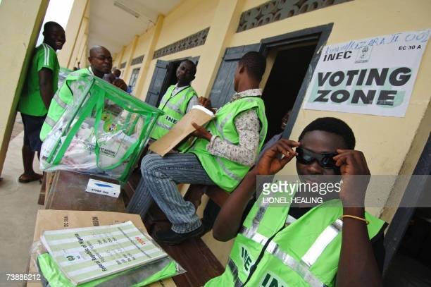 An Electoral Commission official adjusts his glasses at a polling station 14 April 2007 in Bodo Ogoni Territory There have been widespread reports of...
